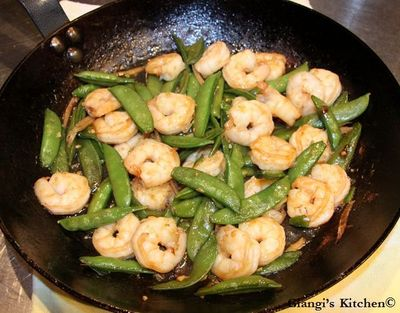 Gingered Stir-Fry Shrimps With Snow Peas: Last night recipe was something new for us. I have an extensive collection of cookbooks and yesterda...[read more at Food Frenzy]