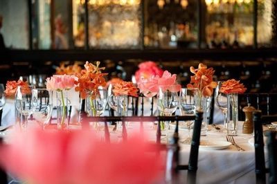 Wedding table settings- I like the idea of setting simple single flowers in a few vases around the table.
