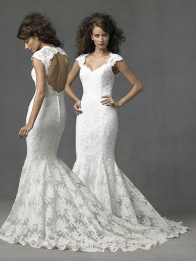 love the keyhole open back with lace, the buttons down the back and the amount of train