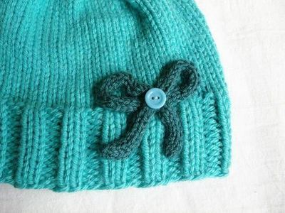 Ribbed Hat With Bow Pattern - KNITTING