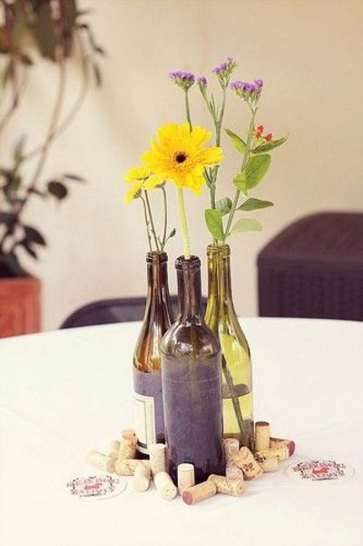 Diy wildflower wine bottle centerpiece how to wedding for Wine themed centerpieces