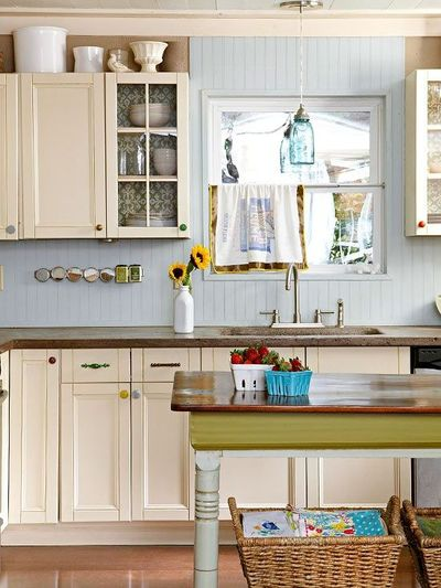Mismatched cabinet knobs and pulls add personality to this for Adding knobs to kitchen cabinets