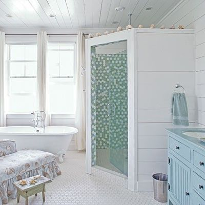 Bathroom With Tiled Shower Surround And Clawfoot Tub