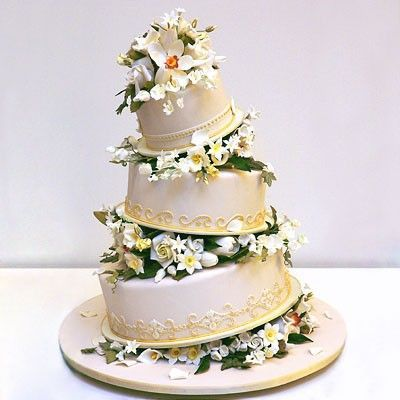 A floral topsy-turvy cake by Ron Ben-Israel / wedding cakes - Juxtapost