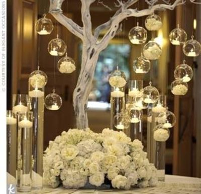 All White Tree Centerpiece With Tea Lights Surrounded By Fl Wedding Ideas
