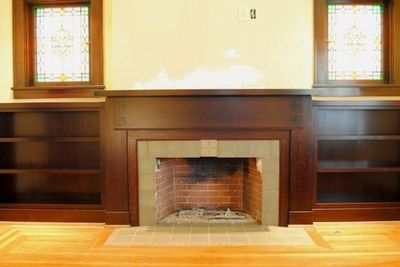 Thinking we may strip paint on fireplace and stain?