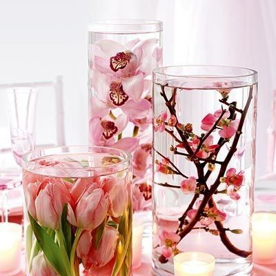Centerpieces--i LOVE this idea!! Flowers in vases of water, with floating tea candles on top :)