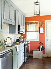 """One-Wall Wonder / Give a narrow galley kitchen a focal point by painting the """"end"""" wall a bright color. A contrasting and vivid hue will draw the eye through the kitchen and make it appear longer. Consider a color that's complementary to a col..."""
