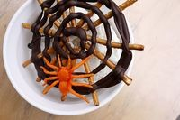 Pretzel and chocolate spiderwebs