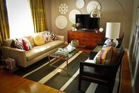 different colored pillows, dresser as tv stand, casual and inviting