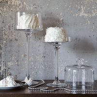 Elevate a display. Sculptural birds top these glass dessert stands, perfect for presenting and covering candy and cakes. Use them to create a display of sweets at the table, or keep them handy on a counter or buffet. $34.00