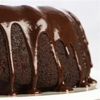 Triple Chocolate Cake: Enhance a devil's food cake mix with semi-sweet chocolate chips and a rich Chocolate Glaze and you will have a dessert good enough for company. By varying the flavoring extract you can make a different cake every time!