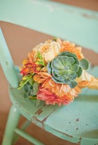 Mint green and peach make the perfect pair for wedding colors. something like this. fabulous bouquet!