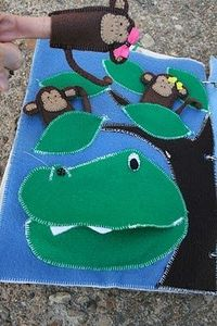 Monkey finger puppets being eaten by an alligator? Now THAT's an original quiet book page. Way funny and cute.