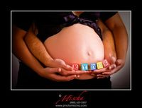maternity pictures with ribbon around belly