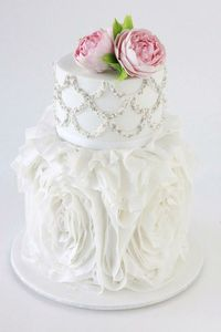 Silver and white wedding cake with ruffles and pink flowers, inspired by Vera Wang
