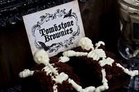 Tombstone Brownies- I found a super cute skeleton parts chocolate mold at Michaels. Bake and cut brownies into squares, chocolate frosted the tops and added brownie crumble to look like dirt. Lastly I bought white chocolate melts to make the skeletons and...