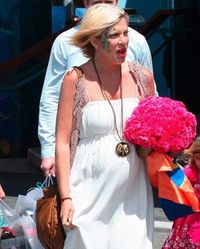 A very pregnant Tori Spelling was spotted around town looking great in a vintage-inspired maxi dress topped off with a gorgeous detailed crochet vest.