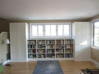 Living room built-in bookshelves and closets using BESTA shelves and PAX wardrobes