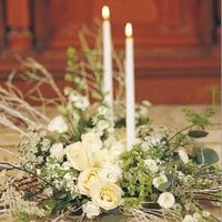 Elegant floral decorations with white candles for winter.