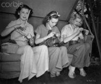 Lucille Ball knitting between scenes on the RKO Radio lot. (she's the one on the far right!) 1936