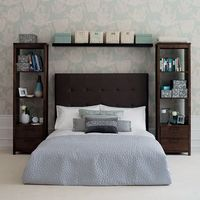 Tall bookshelves instead of a nightstand!
