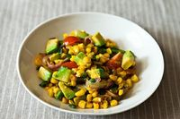 ++ charred corn & avocado salad w/ lime . chili . tomato