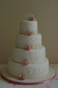 Fondant lace wedding cake with ribbon roses by vanessa-anne, via Flickr