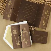 Metallic Torah Folded and tied like a gift, this shimmery mocha invitation will present itself with stately elegance. Add a matching reception card to make the package complete.