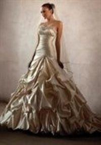 If I were to go the untraditional route I would definitely do a gold wedding dress...however not sure I would be able to pull it off
