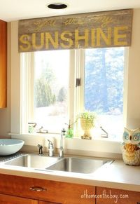 DIY Wood valance over Kitchen window. Cute!