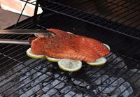 Grill your fish on a bed of lemons to infuse flavor & prevent sticking to the grill.