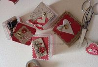 cute... leaving the chipboard pieces natural with the red!!