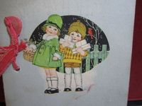 Adorable art deco 1920's christmas card two children carrying presents and holly berry. $2.75, via Etsy.