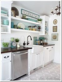 Another white kitchen that looks clean not sterile