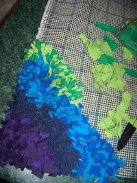 Recycle t shirts into a latch-hook rug.