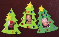 Christmas Tree Picture Frames. Children cut out 2 Xmas Trees, one card one paper. Then decorate and add a photo