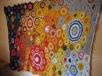 Beautiful crochet art wall hanging by the mom of the blogger at Nero's Post and Patch.