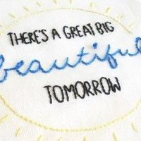 Stitch up some lyrics from a classic Disney attraction with this free embroidery pattern!