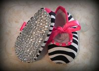 Diamonds on the soles of her shoes!